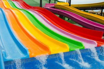 Colorful slides in tropical outdoor park