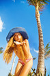 summer holidays concept - woman under the exotic palm tree
