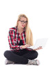 young beautiful astonished blondie woman sitting with laptop iso