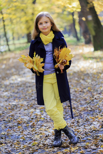 Fashion girl has a fun in autumn park