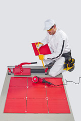 Worker Cut Ceramic Tile Machine Tiling