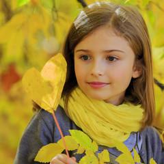 Autumn fun - lovely girl has a fun in autumn park