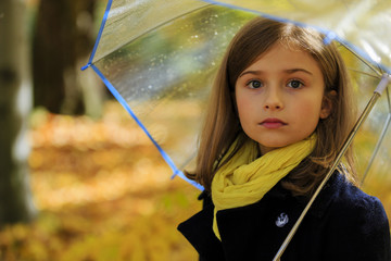 Autumn rain - beautiful girl with an umbrella in park