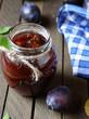 Plum jam in a transparent jar