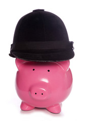 Piggy bank wearing a horse riding hat
