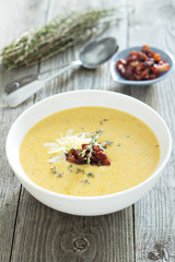 Potato cream soup with bacon and cheese