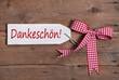 Dankeschön sagen, sich bedanken - Text auf Holzschild rustikal