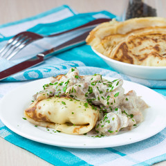 Russian pancakes with chicken and mushrooms champignon