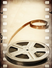 Old motion picture film reel with film strip. Vintage background