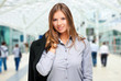 Smiling businesswoman with people on the background