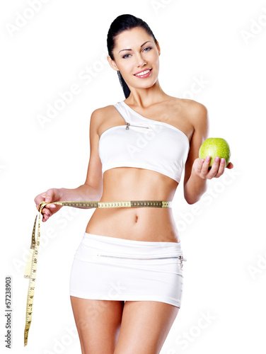 Slimming woman with a measuring tape and apple