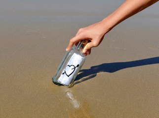Bottle with message of love on the beach