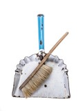 Top view of old dustpan with broom on white background