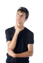 Teenage boy looking up thinking