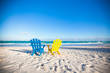 Beach wooden colorful chairs for vacations and summer getaways