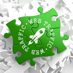 Web Traffic Concept on Green Puzzle Pieces.