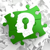 Psychological Concept on Green Puzzle Pieces.