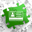ID Card Icon on Green Puzzle.