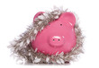 Piggy bank wrapped in Christmas tinsel