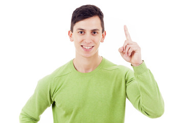 Confident smiling man pointing up, isolated over a white backgro
