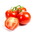 Closeup of tomatoes on the vine isolated on white.