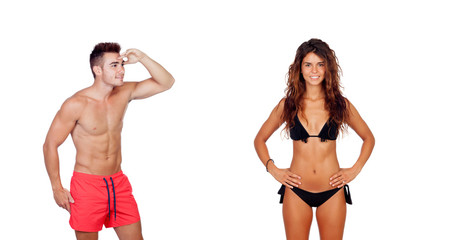 Young boy in swimwear looking at a sexy girl in bikini