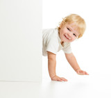 Funny kid on all fours behind wall