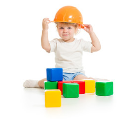 baby boy in hard hat with building blocks