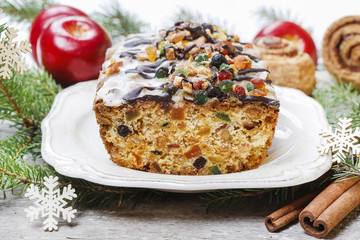 Fruitcake with dried fruits and nuts in christmas setting