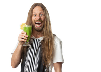 Funny excited man drinking a green vegetable smoothie on white