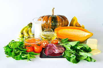 Group of foods with Vitamin A isolated on white
