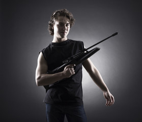 Militant young man with a gun.