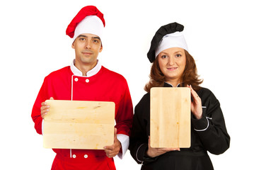 Team of chefs with wooden board