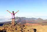 Hiking woman on top happy and celebrating success