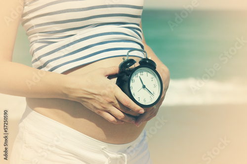 pregnant woman with alarm-clock