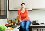 positive  housewife  in home kitchen