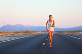 Running woman sprinting on road highway