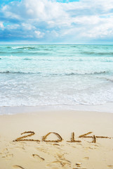 Beautiful view on the beach with 2014 year signs