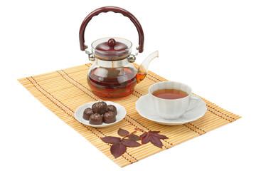 tea and tea utensils isolated on white background