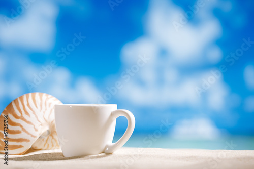 white espresso coffee cup with ocean , seashell, beach and seasc