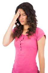 Young cute brunette having headache