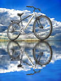 Sports bike against the sky reflected in the water.