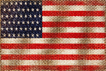 Texture of coarse cloth with the image of the American flag.