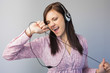 Smiling young brunette listening to music