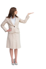 Smiling businesswoman raising her hand