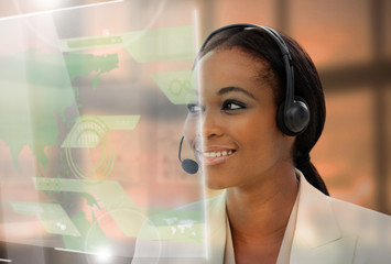 Pleased pretty businesswoman using futuristic interface hologram