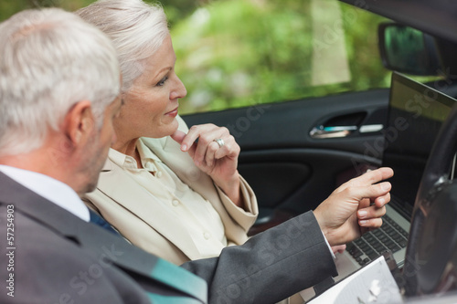 Business people working together in classy cabriolet