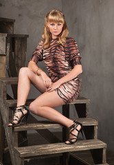 attractive blonde with a leopard-print dress