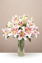Bouquet of pink lillies in a glass vase