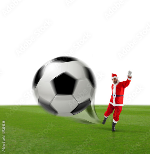 Santa Calus kicking a soccer ball